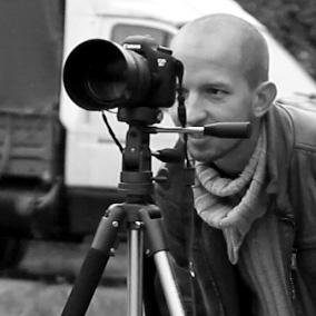 Андрей Кузьмич смотрит в объектив, а по-сути видит там фигу